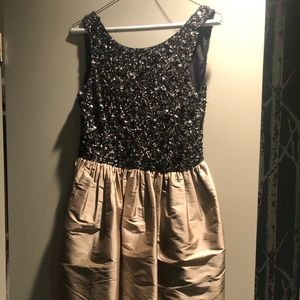 Gold and black beaded dress.